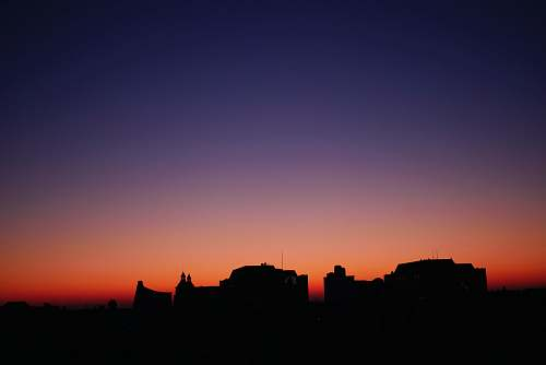 sunset silhouette of buildings\ sky