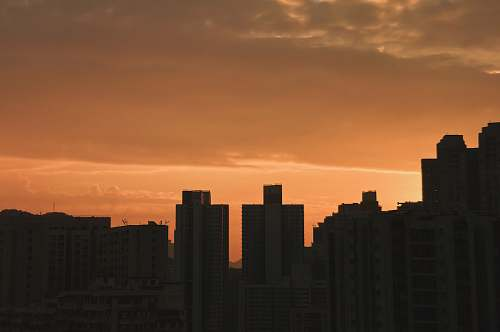 outdoors silhouette of high-rise building during golden hour sky