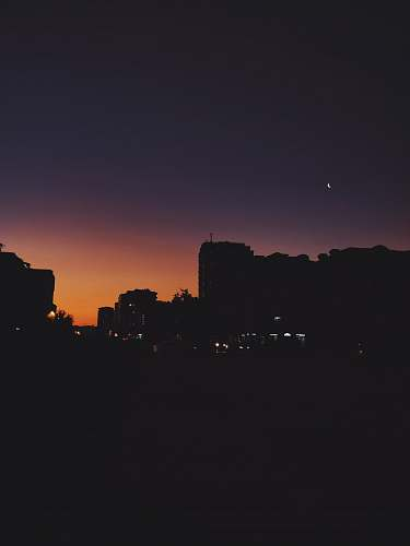 silhouette silhouette of high rise buildings outdoors