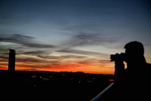 outdoors silhouette of man taking photo dawn