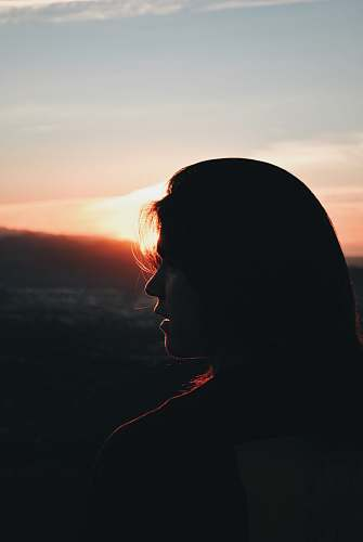 outdoors silhouette of woman facing right during golden hour silhouette