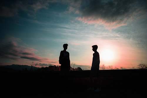 silhouette silhouette photography of two men outdoors