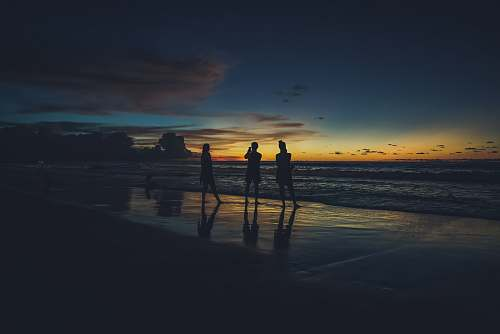 outdoors three person on the seashore photography ocean