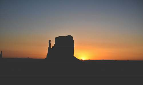nature silhouette of rock formation during golden hour sky
