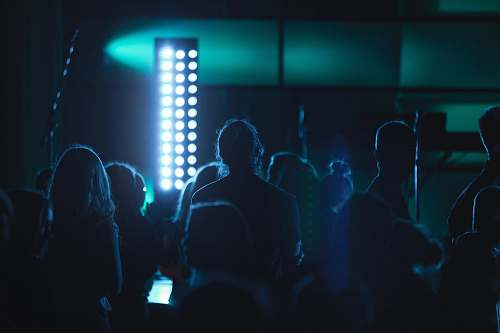 blue people standing near tower light inside room crowd