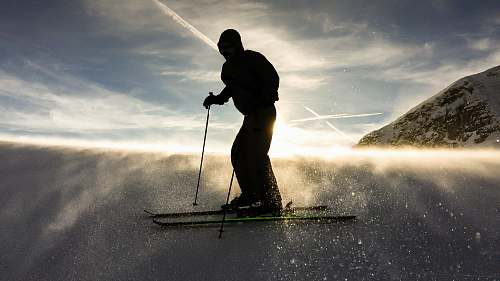 person silhouette of man doing ski human