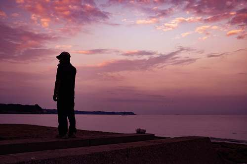person silhouette of man standing on seashore human