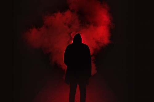 person silhouette of person on a dark place with smoke silhouette