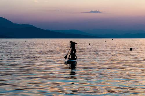 person silhouette of person riding on boat greece