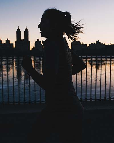 person silhouette photo of woman running human