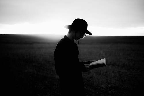 people man reading book black-and-white