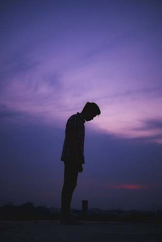 human man standing on ground standing