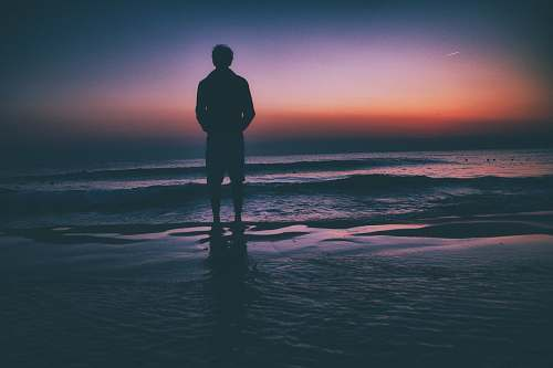 people man standing on seashore during sunset human