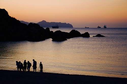 silhouette people on beach human