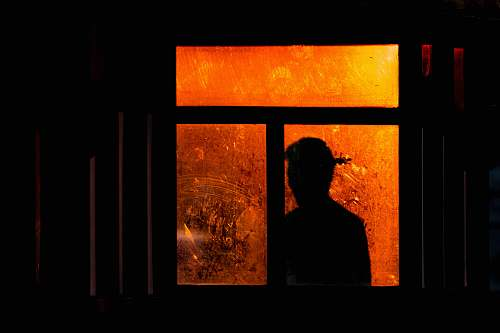 people silhouette of a person at the window human