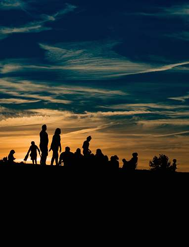 silhouette silhouette of people during golden hour human