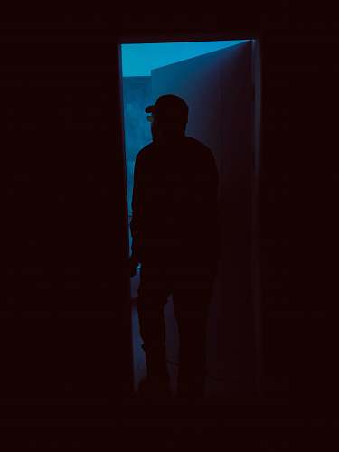silhouette silhouette of person entering door human