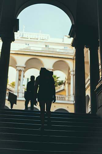 human silhouette of person standing on stairs people
