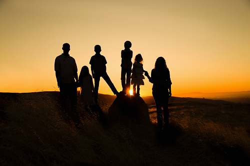 silhouette silhouette photography of family during golden hour human