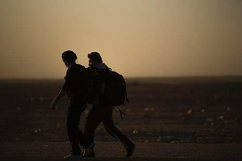 human two men walking silhouette
