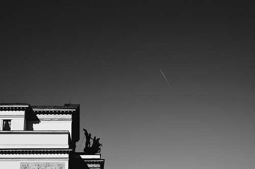 sculpture grayscale photo architecture
