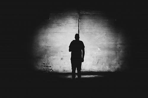 human grayscale photography of person standing black-and-white