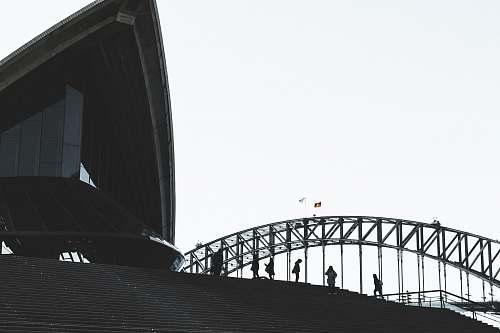 building low angel photography of people standing near bridge bridge