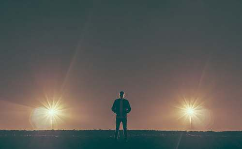 person man standing in the middle of nowhere man