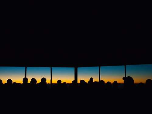 sunset people inside building sunrise