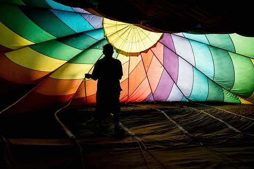 photo person person holding parachute hot air balloon free for commercial use images