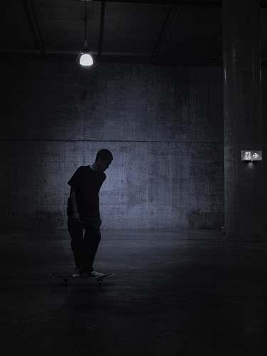 lighting person standing in room grey