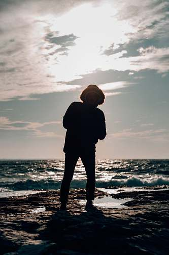 nature person standing on the seashore ocean