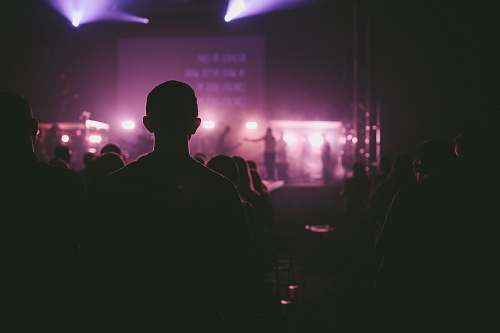 music photo of man facing on stage stage