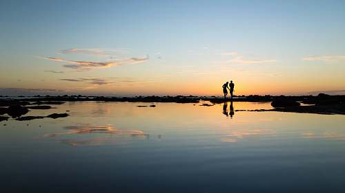 sunset rule of thirds photography of silhouette of two persons people