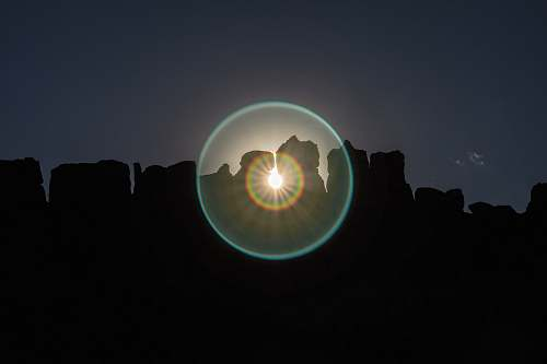 flare scenery of silhouette of rock formation rock