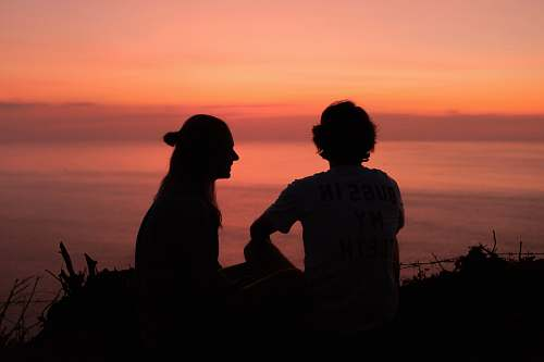 person silhouette of 2 person during golden hour human