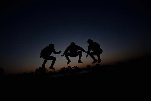 human silhouette of 3 person during dawn person