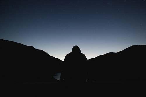 night silhouette of a person facing sunrise black