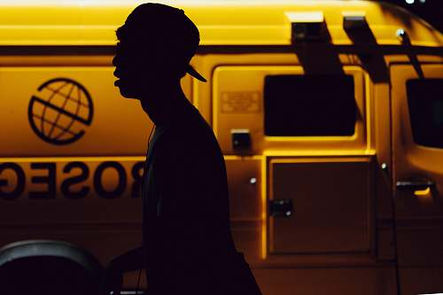human silhouette of boy standing near vehicle person