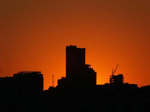 nature silhouette of buildings during golden hour outdoors