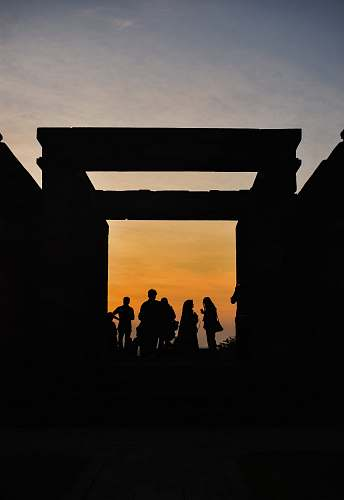 person silhouette of group of men during sunset human