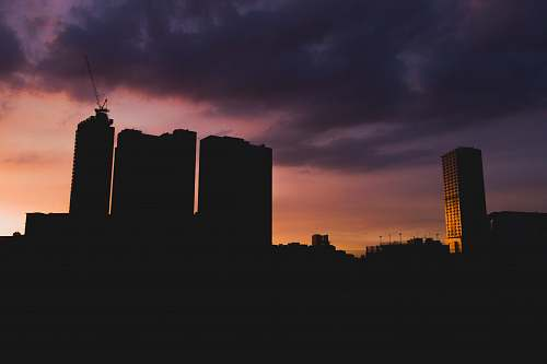 nature silhouette of high-rise buildings during sunset outdoors