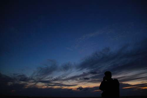 nature silhouette of man during dusk outdoors