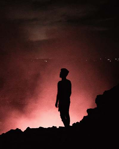 human silhouette of man during nighttime nature