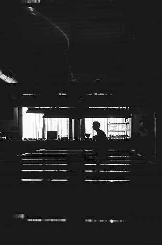 photo human silhouette of man near window black-and-white free for commercial use images