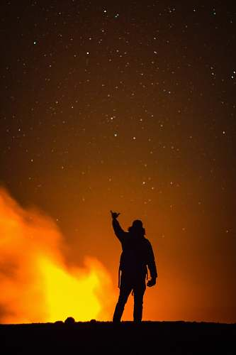 human silhouette of man raising right hand person