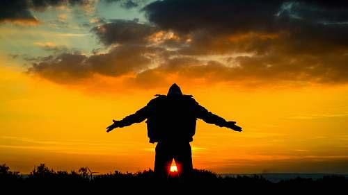 nature silhouette of man spreading its arm dinnington
