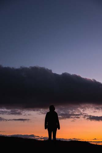 nature silhouette of man standing on mountain outdoors
