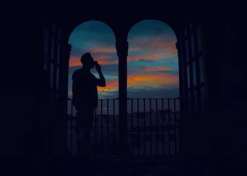 human silhouette of man standing on terrace person