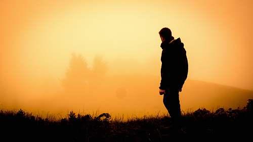 human silhouette of man standing open field people